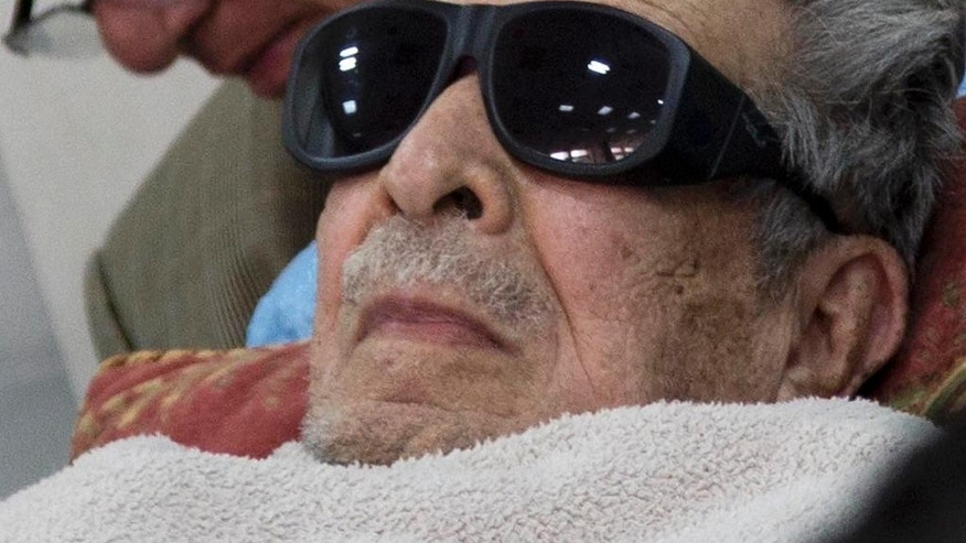 FILE - In this Jan. 5, 2015 file photo, Guatemala's former dictator Jose Efrain Rios Montt arrives on a gurney wearing sunglasses to court where he faces charges of genocide and crimes against humanity in Guatemala City. A Guatemalan court ordered on Thursday, July 23, 2015, Rios Montt be put in a psychiatric hospital for nine days' observation, delaying his possible retrial on genocide charges. The court order seeks to evaluate the 89-year-old ex-general's mental and physical health following a report that found him incompetent to stand trial. (AP Photo/Luis Soto, File)