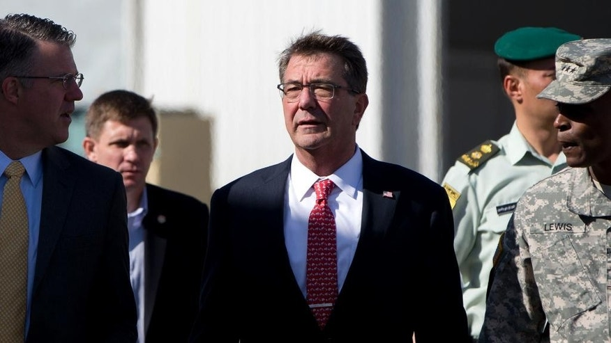 U.S. Defense Secretary Ash Carter, joined by U.S. Army Lt. Gen. Ron Lewis, right, and Chief of Staff Eric Rosenbach, left, walks the tarmac before boarding his plane at Queen Alia Airport in Amman, Jordan, Thursday, July 23, 2015, en route to Baghdad, Iraq. Carter is on a week long tour of the Middle East focused on reassuring allies about Iran and assessing progress in the coalition air campaign against the Islamic State in Syria and Iraq. (AP Photo/Carolyn Kaster, Pool)