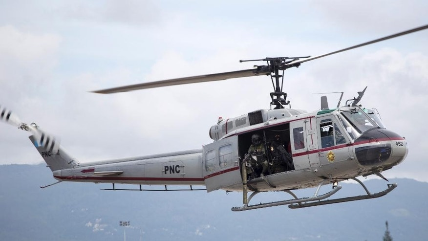 A police helicopter carrying on board Guatemalan drug trafficking suspect Jairo Orellana Morales lands at an Air Force base as in Guatemala City, Friday, July 24, 2015. Orellana, an alleged member of the Zetas drug organization in Guatemala, is being extradited to the United States where faces federal drug trafficking charges. Court records indicate he was scheduled to be arraigned in U.S. federal court in Washington later Friday. (AP Photo/Luis Soto)