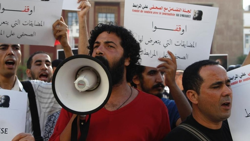 Activist shouts slogans in support of editor Ali Mrabet in front of parliament in Rabat, Morocco on July 24, 2015. Moroccan journalists and activists are calling on the government to end the harassment of Mrabet, who is on a hunger strike. (AP Photo/Paul Schemm)