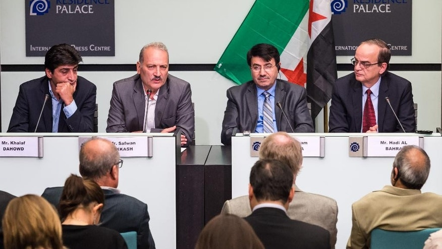 "The President of the National Coalition for Syrian Revolutionary and Opposition Forces Hadi al-Bahra, right, his Vice-President Hisham Marwah, 2nd right, together with members of the National Coordination Body Safwan Akkash, 2nd left, and Khalaf Dahowd address the media during a joint press conference at the International Press Center in Brussels on Friday July 24, 2015. Syria's two main political opposition groups agreed on Thursday on a unified ""roadmap"" for a political solution to the country's long-running civil war, representatives of the groups said.(AP Photo/Geert Vanden Wijngaert)"
