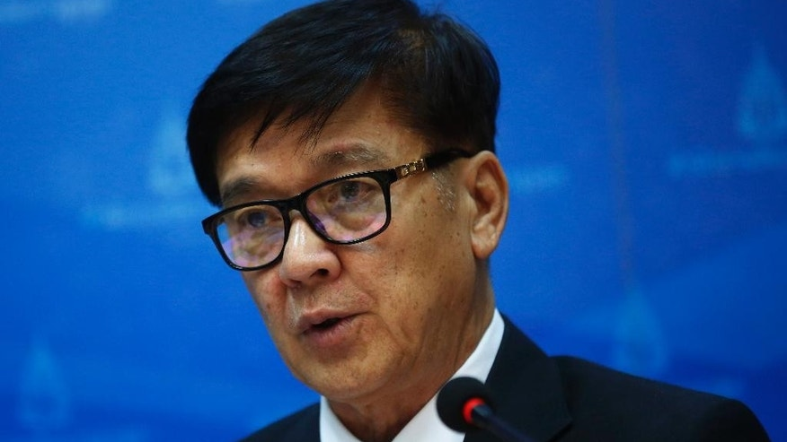Office of the Attorney General spokesman Wanchai Roujanavong talks to reporters during a press conference in Bangkok, Thailand, Friday, July 24, 2015. Thailand's state prosecutors recommended charges against more than 100 people, including a Thai army general, in a multinational human trafficking scandal that came to light after dozens of bodies were discovered in the country's south earlier this year, a spokesman said Friday. (AP Photo/Sakchai Lalit)