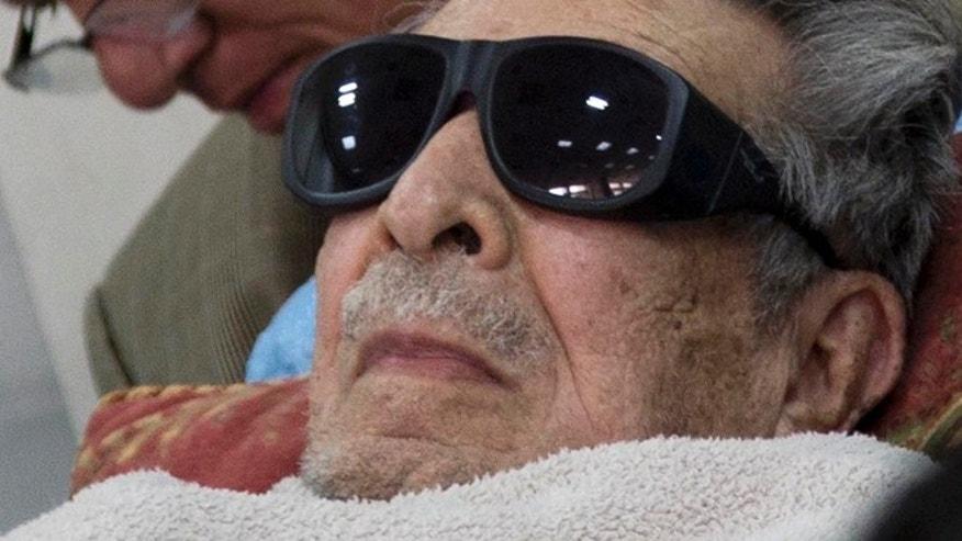 FILE - In this Jan. 5, 2015 file photo, Guatemala's former dictator Jose Efrain Rios Montt arrives on a gurney wearing sunglasses to court where he faces charges of genocide and crimes against humanity in Guatemala City. A Guatemalan court ordered on Thursday, July 23, 2015, Rios Montt be put in a psychiatric hospital for nine days observation, delaying his possible retrial on genocide charges. The court order seeks to evaluate the 89-year-old ex-general's mental and physical health following a report that found him incompetent to stand trial. (AP Photo/Luis Soto, File)