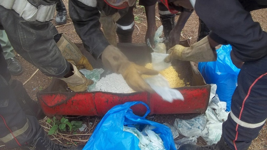 June 29, 2014 - FILE photo of Senegalese police preparing to incinerate methamphetamines seized at the Malian border in Tambacounda, Senegal. Drug enforcement officials say West African gangs are producing and exporting hundreds of millions of dollars in meth per year.