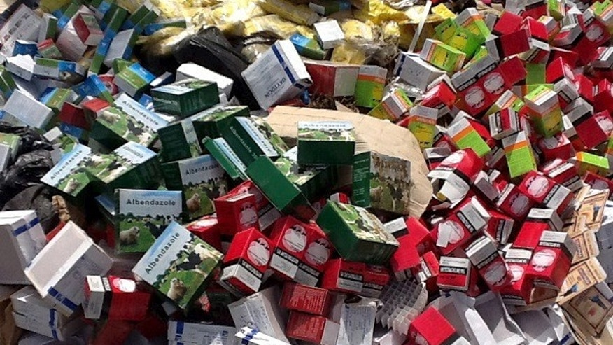 June 22, 2013 - FILE photo of iIlegal and counterfeit drugs seized by Senegalese authorities before an incineration in Tambacounda, Senegal.  Drug enforcement officials say West African criminals are producing and exporting hundreds of millions of dollars in methamphetamines a year, and shipping it to Asia.