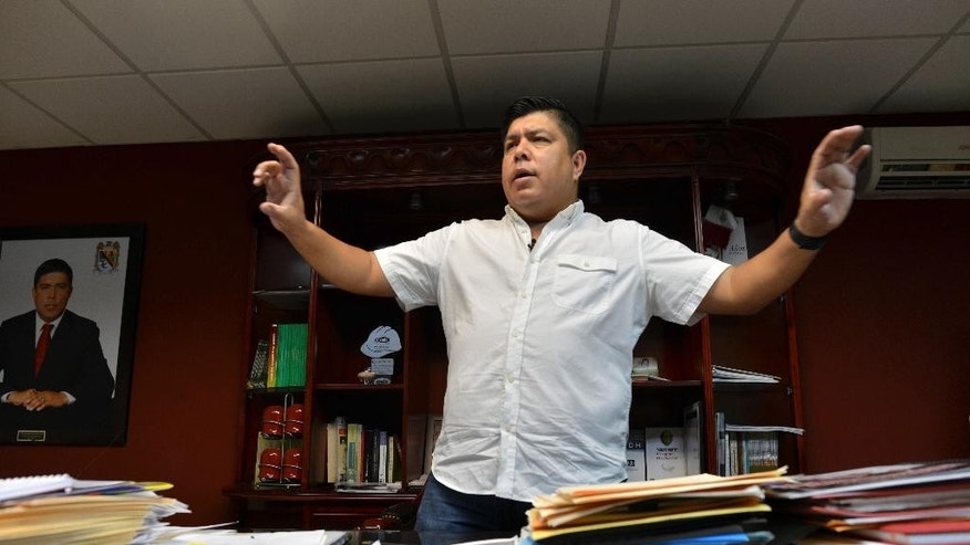 "In this July 20, 2015 photo, Mayor Mario Valenzuela speaks during an interview in Badiraguato, Mexico. ""I don't see a single building producing jobs, a single piece of public works, a soccer field, a sewer, a school, water systems, a clinic or hospital, not a single one that you can say was built by drug traffickers or their money,"" Valenzuela said about his the small mountain town that is part of drug lord Joaquin ""El Chapo"" Guzman's rags-to-crime riches mythology. (AP Photo/Fernando Brito)"