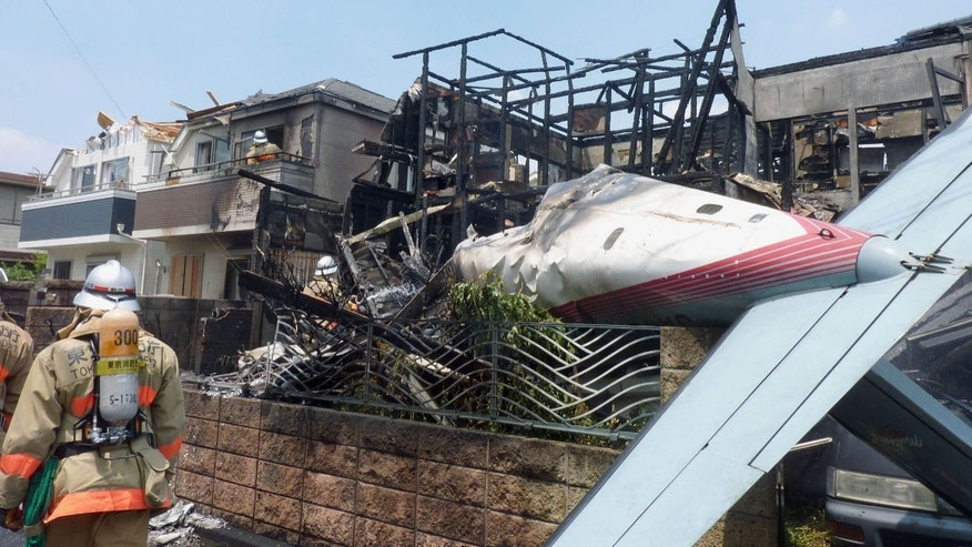 July 26, 2015: The wreckage of a plane is seen at a crash site in the suburbs of Tokyo.