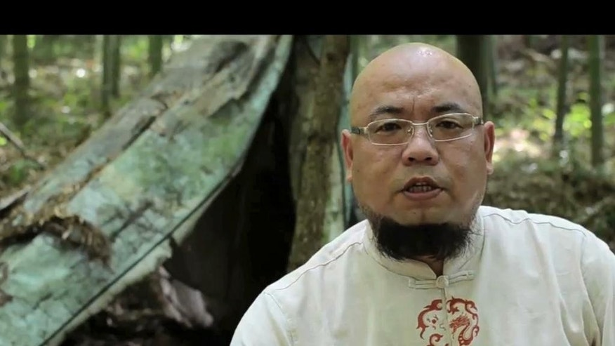 "In this image taken from a July 10, 2012, video provided to APTN, activist Wu Gan is seen with the subtitle ""I am Wu Gan. My internet name is ""Super Vulgar Butcher"" in Sanming city in southeastern China's Fujian province. Wu was formally arrested in July 2015 as part of a recent crackdown on a loosely allied group of more than 200 ""rights-defender lawyers"" and the activists associated with them. He is among dozens who remain detained and may eventually stand trial. (Photo via AP Video)  CHINA OUT"