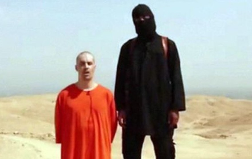"This still from a video released last August by ISIS shows American James Foley with a man believed to be Mohammed Emwazi, formerly known by the alias, ""Jihadi John."""
