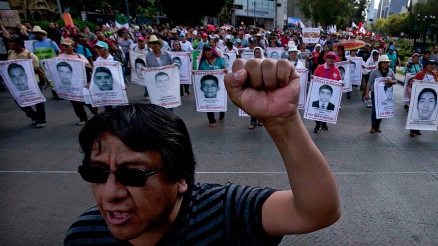 Relatives of the 43 missing students during a protest in Mexico City, Sunday, July 26, 2015.