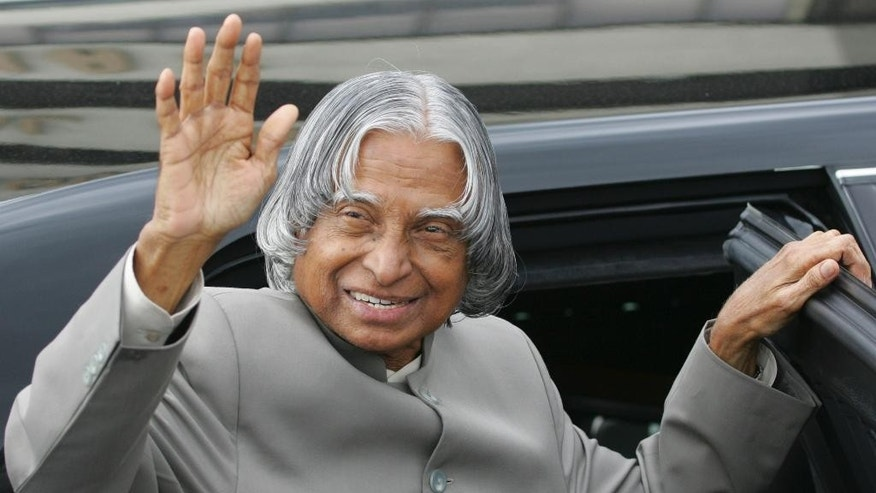 FILE- In this Feb. 3, 2006 file photo, the then Indian President A.P.J. Abdul Kalam waves to well-wishers prior to boarding his limousine upon arrival at the Ninoy Aquino International Airport in Manila. Kalam has died at a hospital after collapsing while delivering a lecture in northeastern India.The president from 2002 until 2007 was known as the father of the country's military missile program. He was 83. (AP Photo/Bullit Marquez, file)