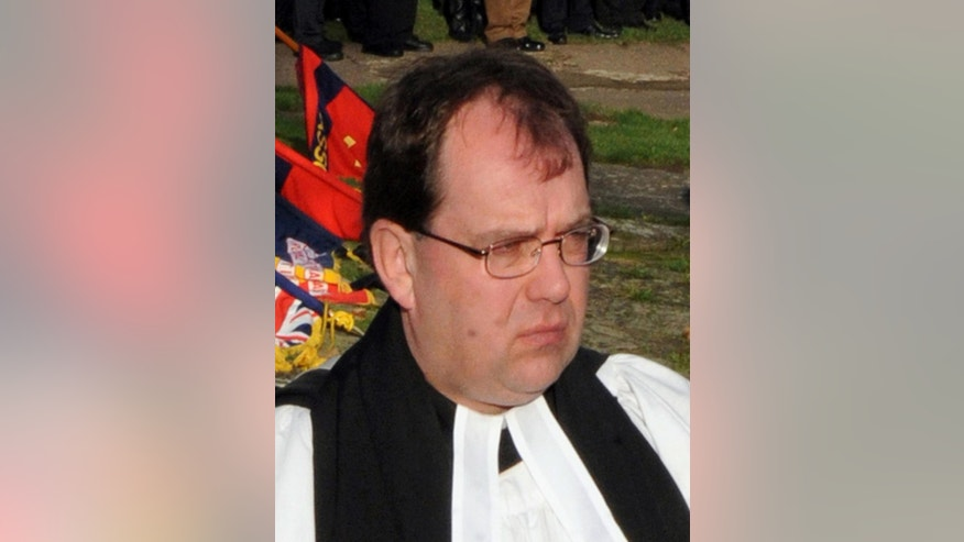 FILE - This is a Nov. 29, 2011 file photo of  Church of England vicar Simon Reynolds. British police said on Friday, July 24, 2015 the 50-year-old, who was convicted of pocketing around 24,000 pounds ($37,000) of church funds, may have travelled to mainland Europe and are asking the missing Church of England vicar to return.  (Anna Gowthorpe/PA via AP, File) UNITED KINGDOM OUT