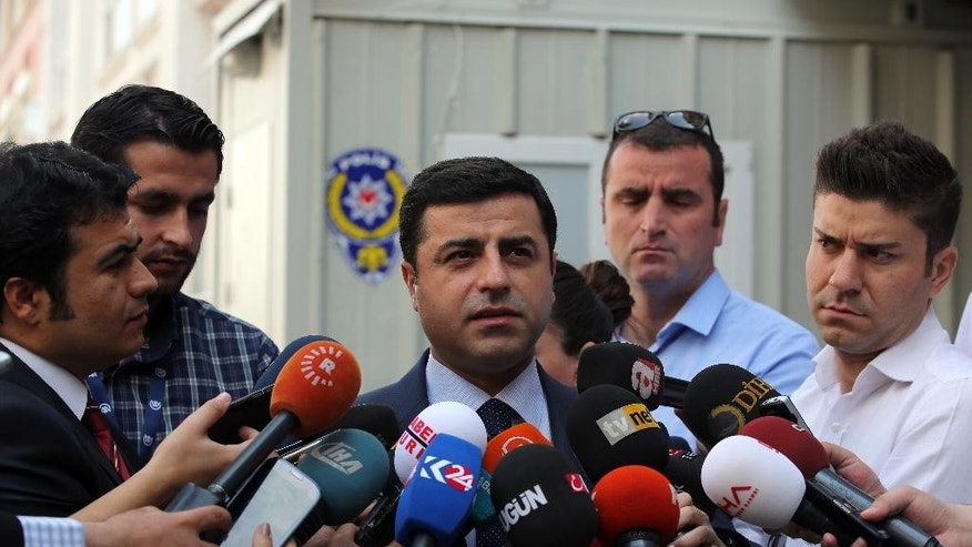 Pro-Kurdish Peoples' Democracy Party leader Selahattin Demirtas speaks to the media about Turkey's airstrikes against Kurdish rebel bases in Iraq, in Ankara, Turkey, Monday, July 27, 2015. Turkey's unexpected move to launch simultaneous air raids not only against the Islamic State group but also Kurdish rebels risks ending of a period of relative calm that has been boon for Turkey's democracy and economy.  (AP Photo)