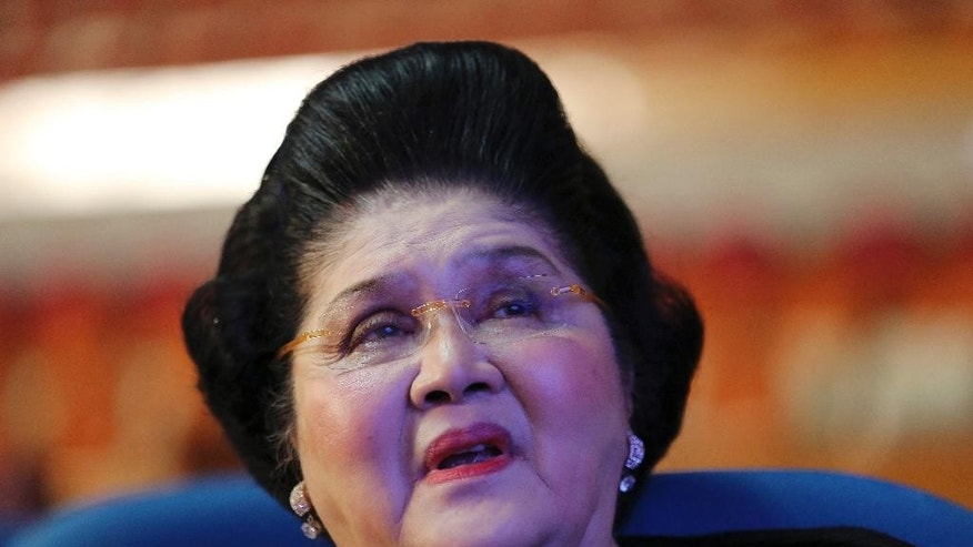 Philippine Representative and former first lady Imelda Marcos waits for the opening of 3rd Regular Session of the 16th Congress at the House of Representatives in suburban Quezon city, north of Manila, Philippines on Monday, July 27, 2015. Philippine President Benigno Aquino III is set to deliver his last State of the Nation Address on Monday at congress. (AP Photo/Aaron Favila)