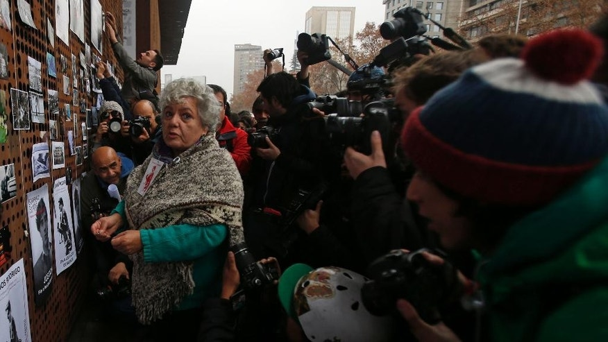 Veronica de Negri, the mother of slain photographer Rodrigo Rojas, attends a tribute to her son, outside the Gabriela Mistral museum, in Santiago, Chile, Tuesday, July 28, 2015. During a street demonstration on July 2, 1986, soldiers doused Rojas and 18-year-old Carmen Quintana with gasoline and set them ablaze. Rojas died four days later. A Chilean judge last week charged seven former members of the military in the burning death of Rojas, and four other ex-soldiers were being questioned on Monday. The charges come after another soldier testified about the case last year, breaking a nearly three-decade pact of silence. (AP Photo/Luis Hidalgo)
