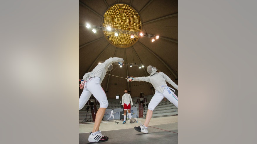 Nora Garam, left, and Judit Gardos of Hungary  practice during a fencing training session  at the European Maccabi Games at the Kuppelsaal  hall in Berlin, Germany, Tuesday, July 28, 2015.  More than 2,000 Jewish athletes are gathering in Berlin for the European Maccabi Games, being held for the first time in Germany, and  at sites constructed by the Nazis for the 1936 Olympics.  (AP Photo/Gero Breloer)