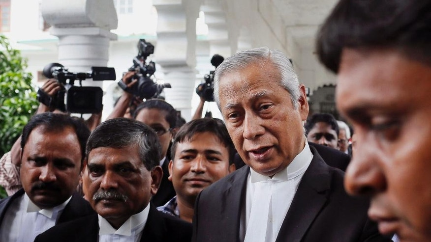Bangladesh's Attorney General Mahbubey Alam, second right, walks out of the Supreme Court during a review of a petition relating to the case of opposition Bangladesh Nationalist Party senior leader Salauddin Quader Chowdhury, convicted of war crimes in Dhaka, Bangladesh, Wednesday, July 29, 2015. Bangladesh's Supreme Court on Wednesday upheld the death sentence for the influential opposition leader and an aide to a former prime minister Khaleda Zia for his role in mass killings during the country's independence war against Pakistan in 1971. (AP Photo/A.M. Ahad)