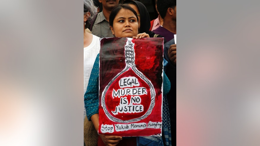 In this July 28, 2015, photo, an Indian woman participates in a protest against the hanging of Yakub Abdul Razak Memon, a convict in the 1993 Mumbai bombings, in Mumbai, India. Jailed for more than two decades over his role in the 1993 Mumbai bombings that killed 257 people, he has made many appeals and is scheduled to be hanged Thursday, July, 30, 2015. (AP Photo/Rajanish Kakade)