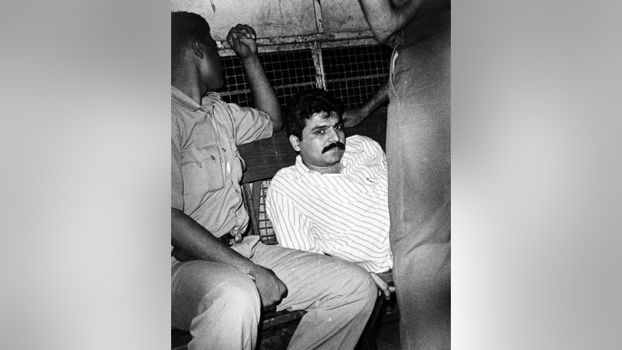 In this Sept. 18, 1993 photo, Yakub Abdul Razak Memon, right, is taken back to a jail in a police vehicle after he was allowed to visit his Mahim residence in Mumbai, Maharashtra state, India. Memon, 53, the only death row convict in India's deadliest terror attack, the 1993 Mumbai bombings that killed 257 people, was hanged early Thursday, July 30, 2015 after the country's president rejected a last-minute mercy plea. He was executed inside a prison in western India where he had been incarcerated since 1994. (Mahendra Parikh/Indian Express Archive via AP)