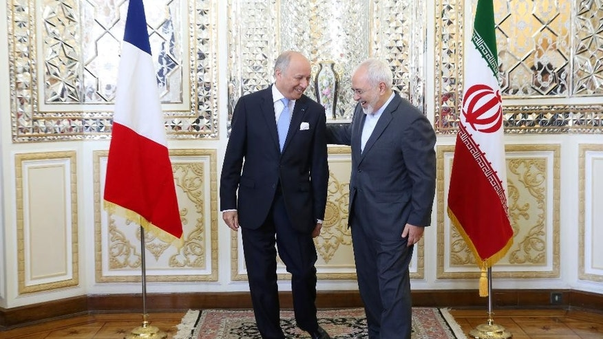 "Iranian Foreign Minister Mohammad Javad Zarif, right, welcomes his French counterpart Laurent Fabius for their meeting, in Tehran, Iran, Wednesday, July 29, 2015. Fabius said Wednesday the time has come for Iran and France to warm up their relations, calling his visit ""an important trip."" (AP Photo/Ebrahim Noroozi)"