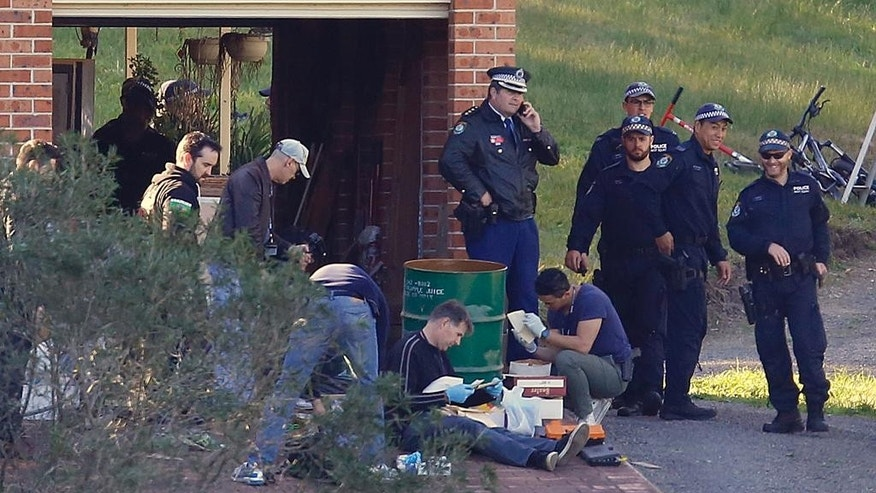Police search the property and family home of Leonard John Warwick in Douglas Park, near Sydney, Australia, Wednesday, July 29, 2015. More than 30 years after series of bombings and shootings left four people dead and terrorized the Australian legal fraternity police have arrested Warwick, a 68-year-old suspect. (David Moir/AAP Image via AP) NO ARCHIVING, AUSTRALIA OUT, NEW ZEALAND OUT, PAPUA NEW GUINEA OUT, SOUTH PACIFIC OUT, NO SALES