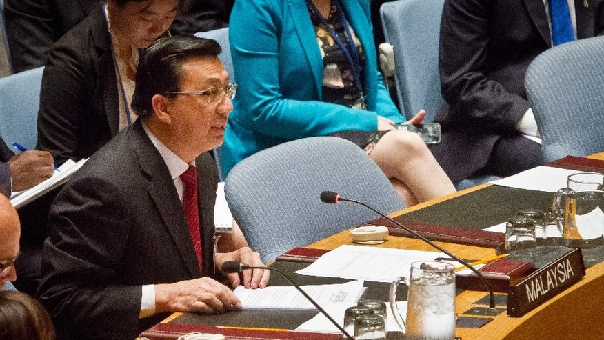 Dato' Sri Liow Tiong Lai, Minister of Transport of Malaysia, speaks before a vote on a draft resolution in the Security Council to create a tribunal to prosecute those found responsible for the downing of Malaysia Airlines Flight 17 over eastern Ukraine, Wednesday, July 29, 2015 at U.N. headquarters. (AP Photo/Bebeto Matthews)