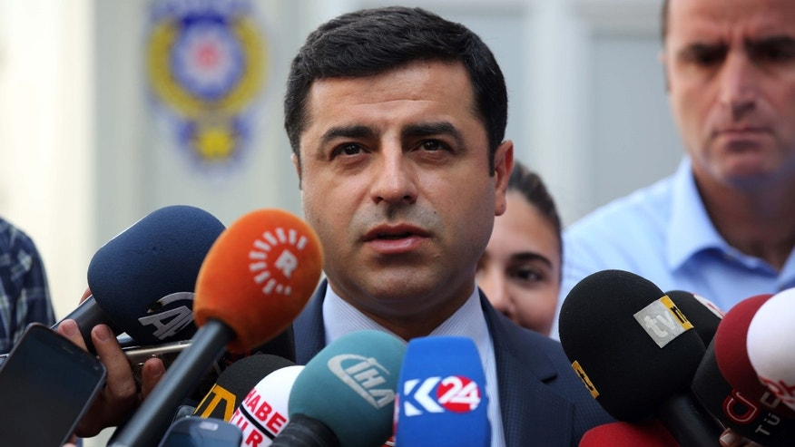 July 27, 2015: Pro-Kurdish Peoples' Democracy Party leader Selahattin Demirtas speaks to the media about Turkey's airstrikes against Kurdish rebel bases in Iraq, in Ankara, Turkey.