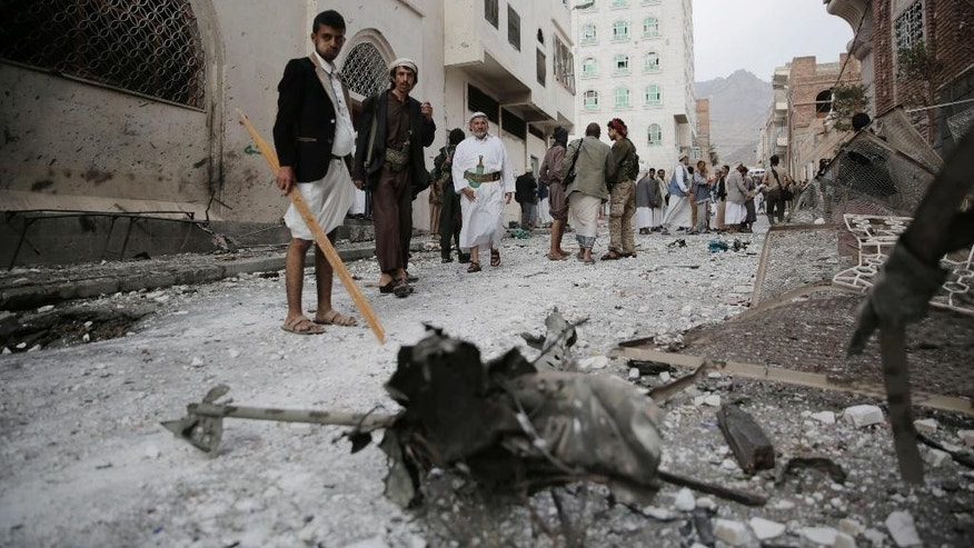 Shiite fighters known as Houthis inspect the site of a car bomb attack next to a Shiite mosque in Sanaa, Yemen, Wednesday, July 29, 2015. The car bomb exploded in Sanaa, next to the mosque belonging to the minority al-Bohra community, a Shiite sect, killing a few people and wounding several, Yemen's rebel-held Interior Ministry said in a statement. (AP Photo/Hani Mohammed)