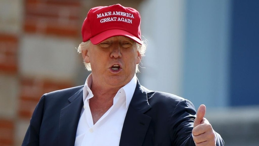 Presidential contender Donald Trump,  speaks to the media after arriving by helicopter during the 1st first day of the Women's British Open golf championship on the Turnberry golf course in Turnberry, Scotland, Thursday, July 30, 2015. (AP Photo/Scott Heppell)