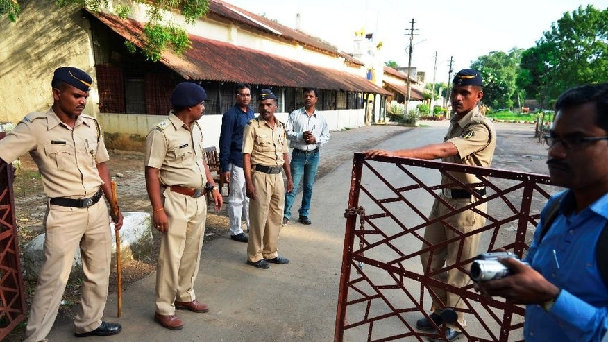 Indian policemen guard outside the Nagpur Central Prison where the 1993 Mumbai blasts convict Yakub Abdul Razak Memon, is currently held in Nagpur, India, Wednesday, July 29, 2015. Memon, an accountant, convicted of providing financial and logistical support in the series of bombings that shook India's business and entertainment hub in 1993 is scheduled to be hanged Thursday, July 30, 2015. About 300 prominent citizens, including at least eight retired judges of the Supreme Court and the Delhi High Court, have urged India's president to commute Memon's sentence to life in prison, reflecting what appears to be growing uneasiness in India with the death penalty.(AP Photo)