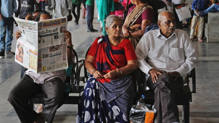 "An Indian man reads a newspaper with the headline ""Memon's Death Sentence"" as he sits at a bus stand in Hyderabad, India, Thursday, July 30, 2015. Memon, 53, an Indian accountant and the only person sentenced to death for his role in the 1993 Mumbai bombings that killed 257 people — the country's worst terrorist attack — was hanged Thursday on his birthday, after the president rejected a last-minute mercy plea amid a debate over the capital punishment. (AP Photo/Mahesh Kumar A.)"