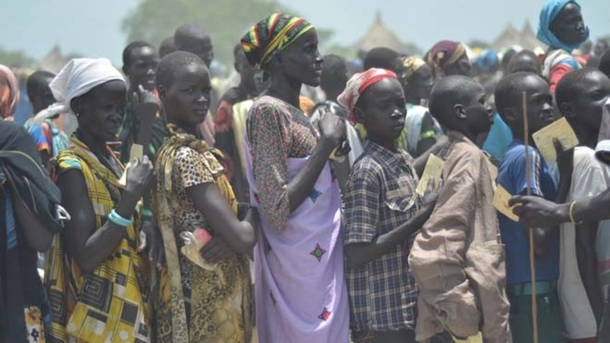 July 25: People waiting for food distribution in Dablual. Soldiers believed to be South Sudanese government troops and allied militia stole relief food and killed seven people in an attack in a rebel-held part of Unity state, a local official said.