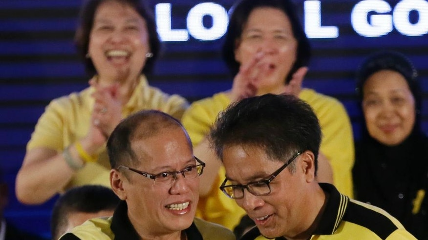 "Interior Secretary Manuel ""Mar"" Roxas II, right, chats with Philippine President Benigno Aquino III shortly after Aquino endorsed him as the administration's standard bearer for the May 2016 presidential elections, Friday, July 31, 2015 at the historic Club Filipino in suburban San Juan, east of Manila, Philippines. The 58-year-old former congressman and senator said he was honored to be endorsed by Aquino of the dominant Liberal Party. (AP Photo/Bullit Marquez)"