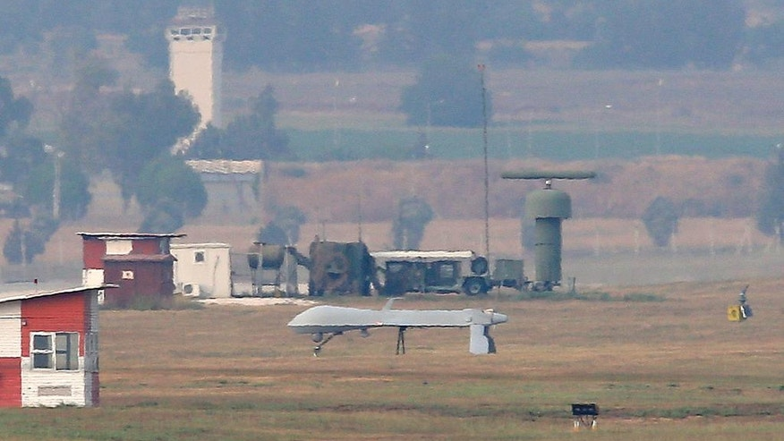 An unmanned aerial vehicle maneuvers on the runway after it landed at the Incirlik Air Base, on the outskirts of the city of Adana, southern Turkey, Thursday, July 30, 2015. After months of reluctance, Turkish warplanes last week started striking militant targets in Syria and agreed to allow the U.S. to launch its own strikes from Turkey's strategically located Incirlik Air Base. In a series of cross-border strikes, Turkey has not only targeted the IS group but also Kurdish fighters affiliated with forces battling IS in Syria and northern Iraq and Kurdistan Workers' Party, or PKK positions within Turkey. (AP Photo/Emrah Gurel)
