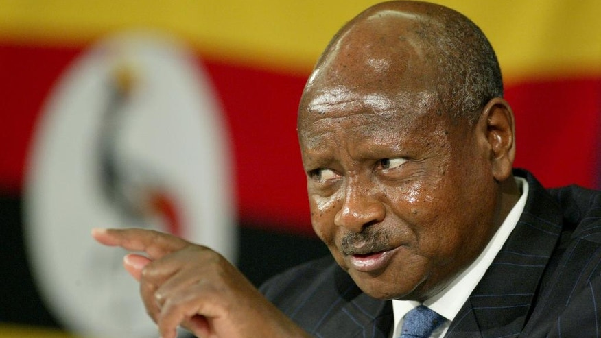 FILE - In this Friday, Nov. 25, 2005 file photo, President of Uganda Yoweri Museveni gestures as he speaks during a news conference in a hotel in St Julians, Valletta, Malta. Uganda's long-serving president on Friday, July 31, 2015 declared his bid for re-election in 2016, saying the country needs him to stick around to continue its economic development. President Yoweri Museveni, who took power by force in 1986 before winning elections in 1996, said he needs another term to bring this poor East African country up to middle-income status. He has been re-elected three times before. (AP Photo/Martin Cleaver,File)