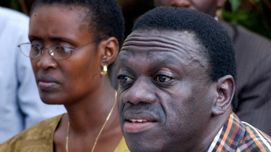 FILE-- In this Tuesday Jan. 3, 2006 file photo, Uganda's main opposition leader Kizza Besigye, right, and his wife, Winnie Byanyima, left, address a news conference in Kampala, Uganda. Uganda's long-serving president on Friday, July 31, 2015 declared his bid for re-election in 2016, saying the country needs him to stick around to continue its economic development. He will face a challenge from Kizza Besigye, who is widely expected to become the leader of a proposed united opposition (AP Photo, file)