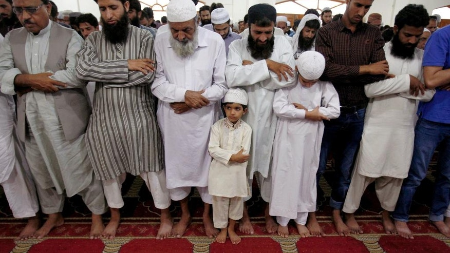 Supporters of a Pakistani religious group 'Jamaat-ud-Dawa' attend funeral prayers for Taliban leader Mullah Mohammad Omar at a mosque in Islamabad, Pakistan, Saturday, Aug. 1, 2015. Afghanistan's Taliban on Thursday confirmed the death of Mullah Omar, who led the group's self-styled Islamic emirate in the 1990s, sheltered al-Qaida through the 9/11 attacks and led a 14-year insurgency against U.S. and NATO troops. (AP Photo/Anjum Naveed)