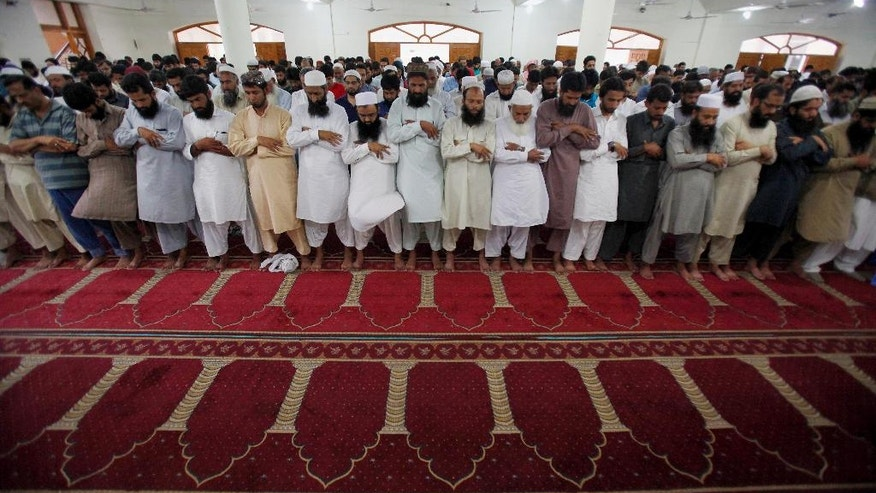 Supporters of a Pakistani religious group 'Jamaat-ud-Dawa' offer funeral prayers for Taliban leader Mullah Mohammad Omar at a mosque in Islamabad, Pakistan, Saturday, Aug. 1, 2015. Afghanistan's Taliban on Thursday confirmed the death of Mullah Omar, who led the group's self-styled Islamic emirate in the 1990s, sheltered al-Qaida through the 9/11 attacks and led a 14-year insurgency against U.S. and NATO troops. (AP Photo/Anjum Naveed)