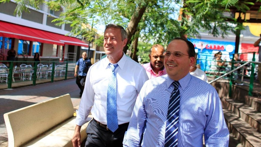 Democratic presidential candidate, former Maryland Gov. Martin O'Malley, left, walks with Jaime Perello, speaker of Puerto Rico's House of Representatives during a campaign stop in San Juan, Puerto Rico, Saturday, Aug. 1, 2015. O'Malley is the first Democratic candidate to campaign in Puerto Rico. (AP Photo/Ricardo Arduengo)