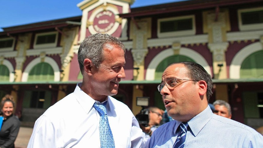 Democratic presidential candidate, former Maryland Gov. Martin O'Malley, left, talks to Jaime Perello, speaker of Puerto Rico's House of Representatives during a campaign stop in San Juan, Puerto Rico, Saturday, Aug. 1, 2015. O'Malley is the first Democratic candidate to campaign in Puerto Rico. (AP Photo/Ricardo Arduengo)