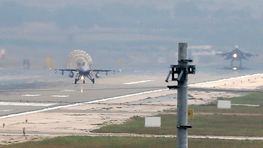 July 30, 2015: Turkish Air Force fighter planes land at Incirlik Air Base, on the outskirts of the city of Adana, southern Turkey.