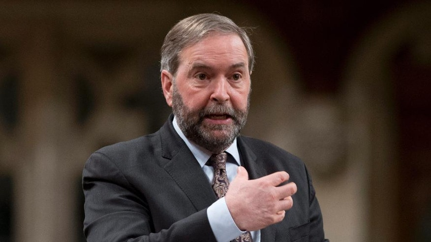 FILE - In this March 30, 2015 file photo, New Democratic Party (NDP) leader Tom Mulcair rises during the debate on the extension of Canada's mission in Iraq during debate in the House of Commons on Parliament Hill in Ottawa, Ontario. Analysts say the NDP have a chance to gain power after winning an election in Alberta, Canada's most conservative province, a few months ago. (AP Photo/The Canadian Press, Adrian Wyld, File)