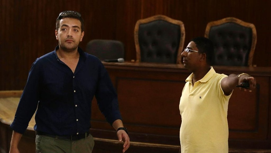 Egyptian Al-Jazeera English journalist Baher Mohammed leaves the defendants cage during his retrial in a courtroom, of Tora prison, in Cairo, Egypt, Sunday, Aug. 2, 2015. An Egyptian court on Sunday again postponed announcing a verdict in the retrial of three Al-Jazeera English journalists, extending the long-running trial criticized worldwide by press freedom advocates and human rights activists. (AP Photo/Hassan Ammar)