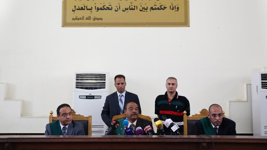 Egyptian Judge Essam Abo Elella reads the verdict of the three Al-Jazeera English reporters case in a courtroom, of Tora prison, in Cairo, Egypt, Sunday, Aug. 2, 2015. An Egyptian court on Sunday again postponed announcing a verdict in the retrial of three Al-Jazeera English journalists, extending the long-running trial criticized worldwide by press freedom advocates and human rights activists. (AP Photo/Hassan Ammar)