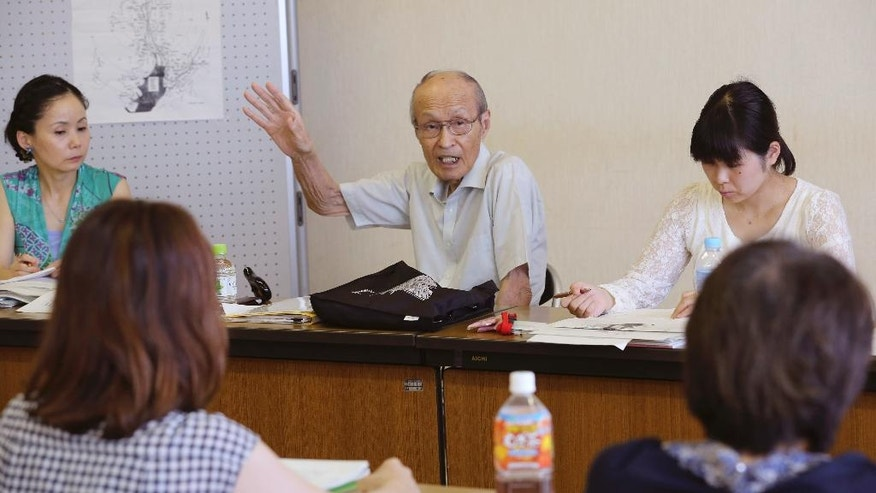 In this Saturday, July 25, 2015 photo, Shigeyuki Katsura, 84-year-old survivor of the Nagasaki atomic bombing, speaks to his audience about his experience 70 years ago, in the western Tokyo suburb of Kunitachi. In a government-organized program, 20 trainees ranging from their 20s to their 70s are studying wartime history, taking public speech lessons from a TV anchor and hearing stories from Katsura and another Kunitachi resident who survived Hiroshima. (AP Photo/Koji Sasahara)