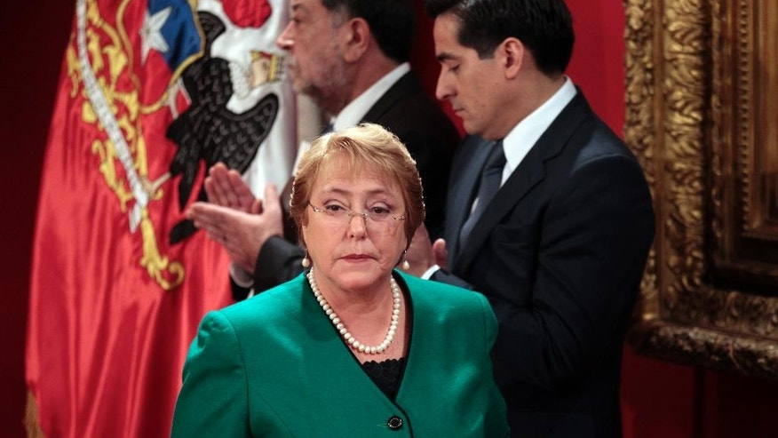 FILE - In this May 11, 2015 file photo, Chile's President Michelle Bachelet attends a ceremony announcing new Cabinet members at the presidential palace La Moneda, in Santiago, Chile. A new poll says Bachelet's approval rating is at its lowest level since she took office last year, dropping to 26 percent, according to a monthly survey released Monday, Aug. 3 by pollster Gfk Adimark. (AP Photo/Luis Hidalgo, File)