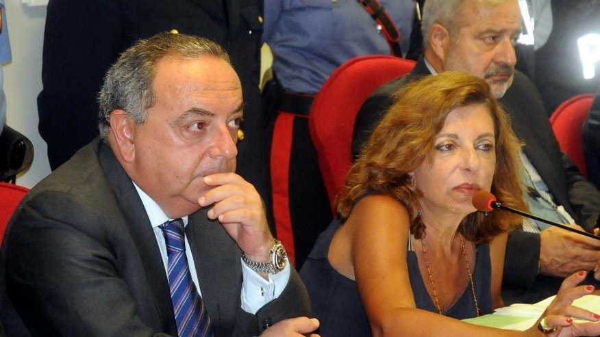 Italian prosecutors Francesco Lo Voi and Maria Teresa Principato speak during a press conference in Palermo, Italy, Monday, Aug. 3, 2015. Italian investigators say they've discovered how the No. 1 Cosa Nostra fugitive communicates with henchmen using written messages buried in dirt or hidden under boulders on Sicilian sheep ranches: in pre-dawn raids Monday in western Sicily, police arrested 11 men suspected of helping Matteo Messina Denaro stay in command despite being on the run since 1993. (AP Photo/Alessandro Fucarini)