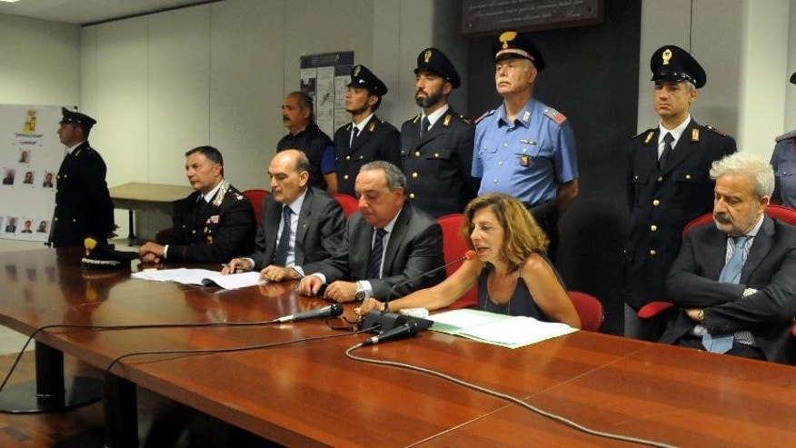 Italian prosecutor Maria Teresa Principato, center, flanked on her right by her colleague Francesco Lo Voi, speaks during a press conference in Palermo, Italy, Monday, Aug. 3, 2015. Italian investigators say they've discovered how the No. 1 Cosa Nostra fugitive communicates with henchmen using written messages buried in dirt or hidden under boulders on Sicilian sheep ranches: in pre-dawn raids Monday in western Sicily, police arrested 11 men suspected of helping Matteo Messina Denaro stay in command despite being on the run since 1993. (AP Photo/Alessandro Fucarini)
