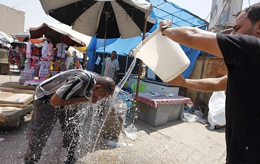 A man cools off during the heat wave in Baghdad. (REUTERS/Ahmed Saad)