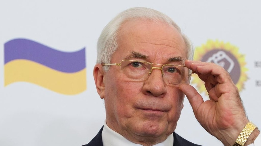 Mykola Azarov gestures as he speaks at a news conference in a Moscow hotel, Monday, Aug. 3, 2015. Ukraine's former prime minister who has fled the country following the ouster of its Moscow-friendly president has announced the creation of a 'Ukraine salvation committee' and pushed for early presidential and parliamentary elections. (AP Photo/Ivan Sekretarev)